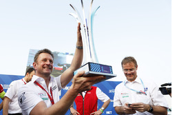Allan McNish, Team Principal, Audi Sport Abt Schaeffler, celebrates with the trophy on the podium