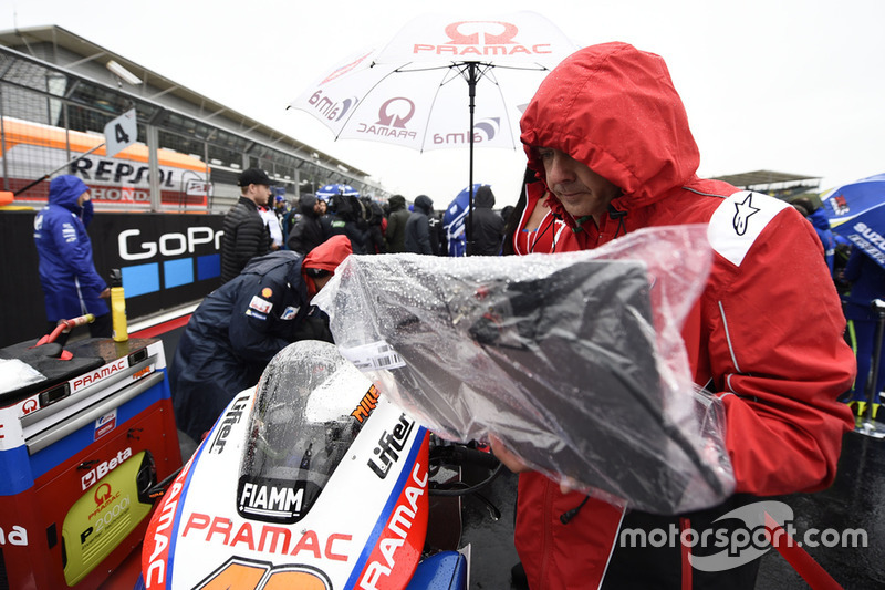 Pramac Ducati team member covers the bike