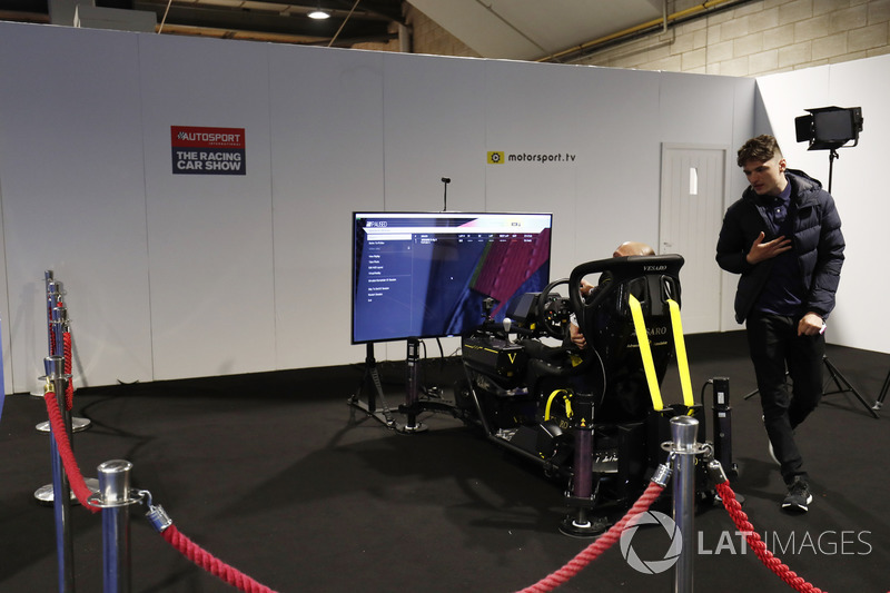 Visitors to the show use a simulator