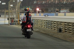 Race Retiree Daniel Ricciardo, Red Bull Racing gets a lift back to the pits on a motorbike