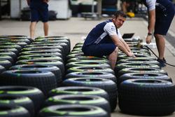 A Williams team member works on Pirellii tyres
