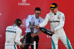 Bonnington, Mercedes AMG F1 Race Engineer, Valtteri Bottas, Mercedes-AMG F1 and Lewis Hamilton, Mercedes-AMG F1 celebrate on the podium with the champagne