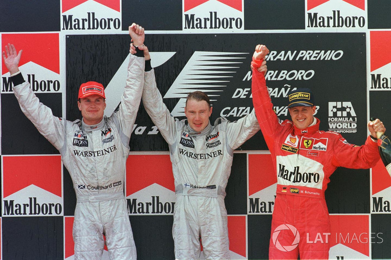 Podium: 1. Mika Häkkinen, 2. David Coulthard, 3. Michael Schumacher