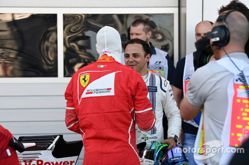 Pole sitter Sebastian Vettel, Ferrari and Felipe Massa, Williams