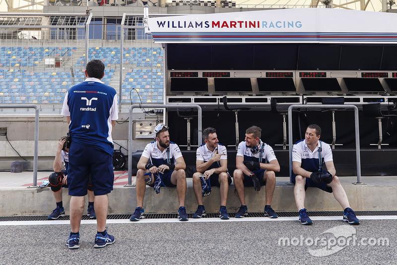 Williams team members in the pit lane