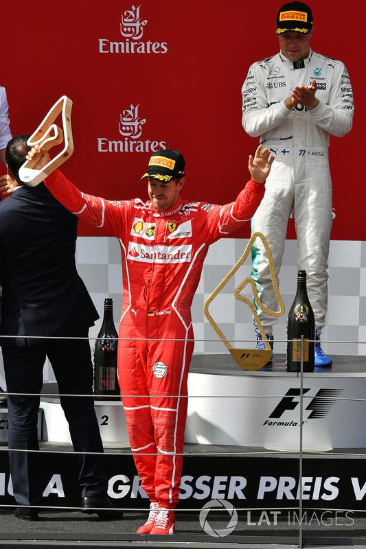 Second place Sebastian Vettel, Ferrari celebrates on the podium
