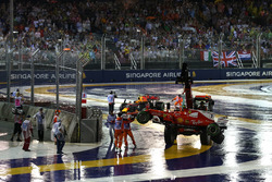 The crashed cars of Max Verstappen, Red Bull Racing RB13 and Kimi Raikkonen, Ferrari SF70H are recovered