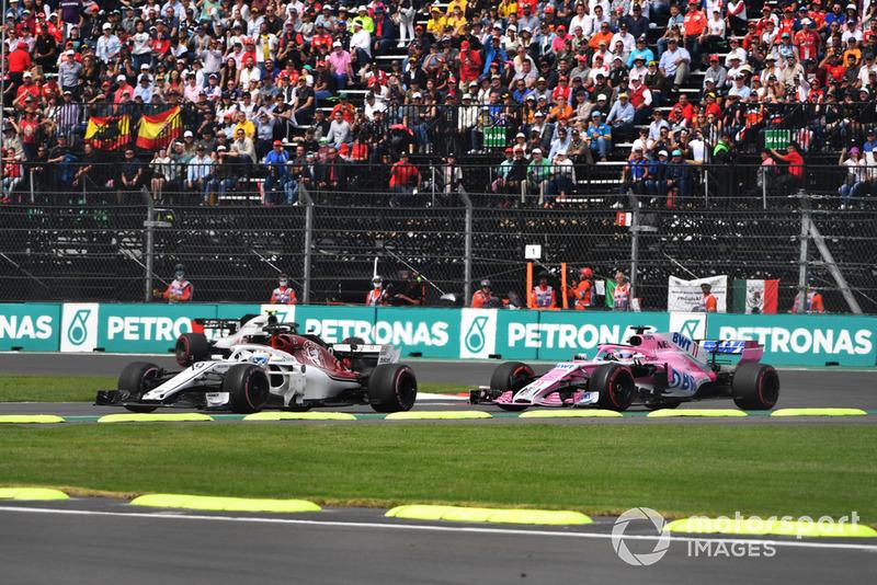 Marcus Ericsson, Sauber C37 and Sergio Perez, Racing Point Force India VJM11