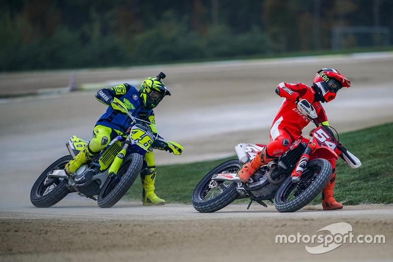 Mattia Pasini leads Valentino Rossi