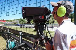 TV Cameraman observes the car of Marcus Ericsson, Sauber C36