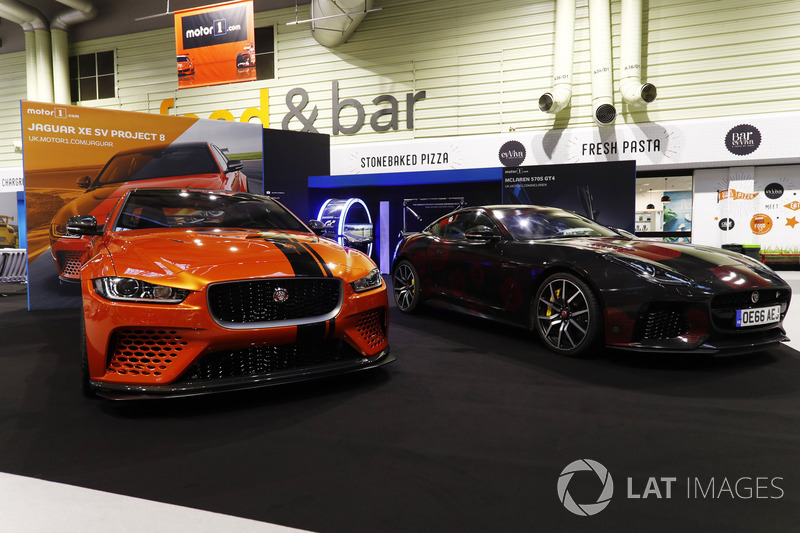 The Jaguar XE SV Project 8 on display, next to an F-Type