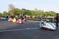 John Holden and Lee Cain take the Isle of Man TT sidecar newcomers on their speed-controlled lap