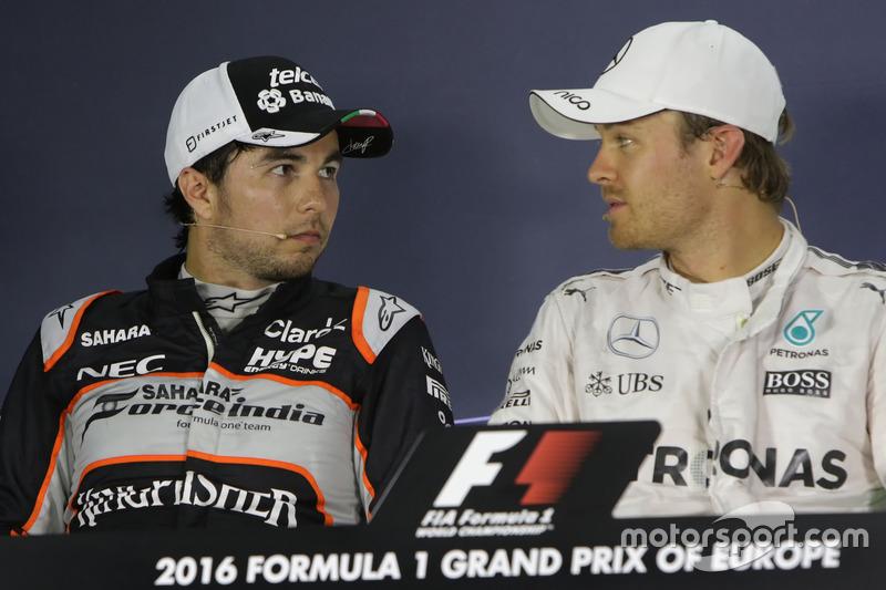 Segundo lugar Sergio Pérez, Sahara Force India F1 y el gandor de la pole Nico Rosberg, Mercedes AMG