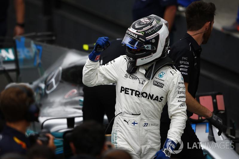 Pole man Valtteri Bottas, Mercedes AMG F1, celebrates in Parc Ferme