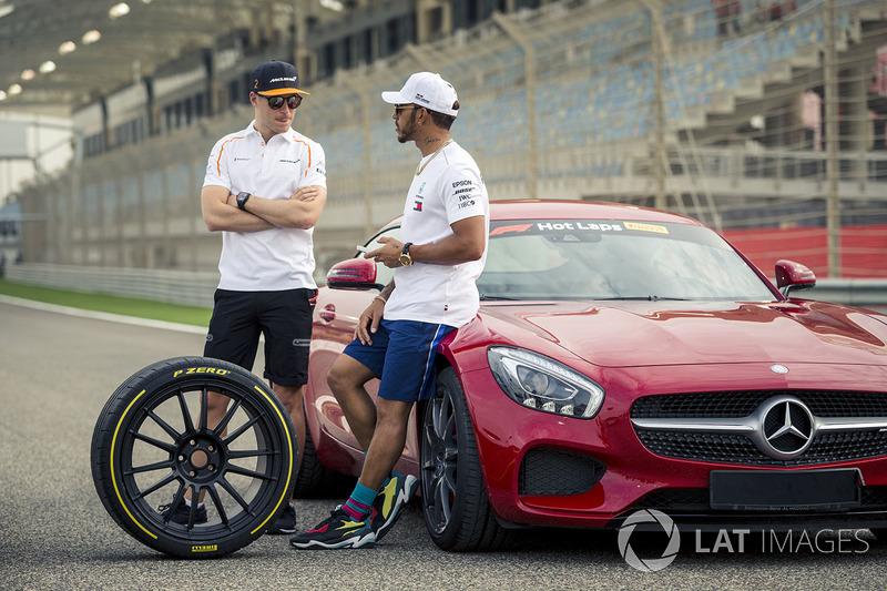 Lewis Hamilton, Mercedes-AMG F1 and Stoffel Vandoorne, McLaren with Pirelli Hot Laps car