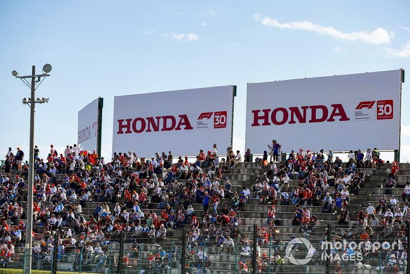 Fans in grandstands await the start