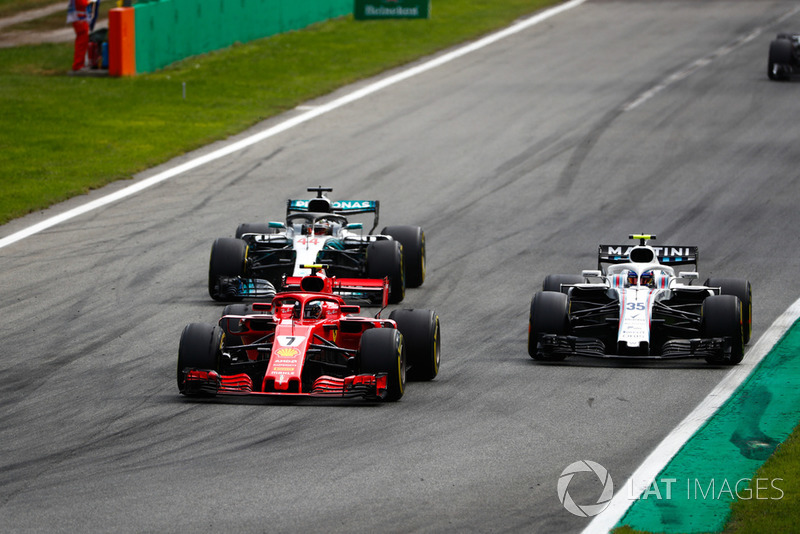 Kimi Raikkonen, Ferrari SF71H, Lewis Hamilton, Mercedes AMG F1 W09, as they put a lap on Sergey Sirotkin, Williams FW41