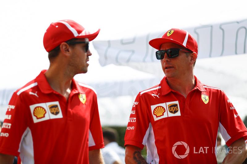 Kimi Raikkonen, Ferrari, e Sebastian Vettel, Ferrari