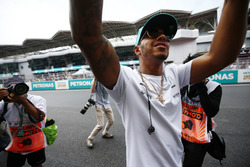 Lewis Hamilton, Mercedes AMG F1, is photographed waving to fans