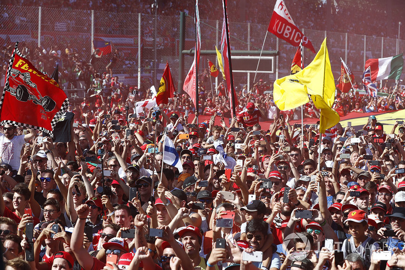 A throng of Ferrari fans invade the circuit after the race