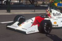Ayrton Senna, McLaren MP4/7A Honda carries the Brazilian flag after his win