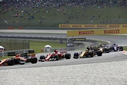 Fernando Alonso, McLaren MCL32 and Sebastian Vettel, Ferrari SF70H at the start of the race