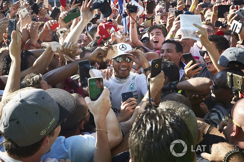 Lewis Hamilton, Mercedes AMG F1, gets mobbed by fans