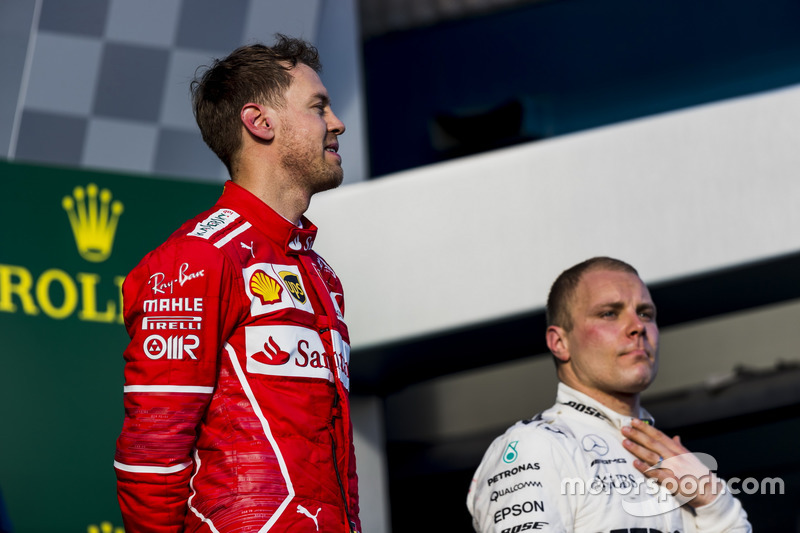 Sebastian Vettel, Ferrari, 1st Position, and Valtteri Bottas, Mercedes AMG, 3rd Position, on the podium