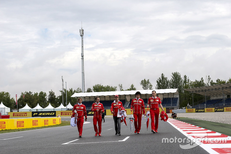 Sebastian Vettel, Ferrari and Riccardo Adami, Ferrari Engineer walk the track