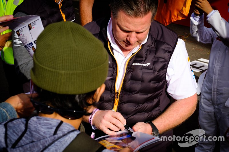 Zak Brown, McLaren Executive Director signs autographs for the fans