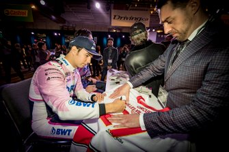 Sergio Perez, Racing Point signs autographs for the fans