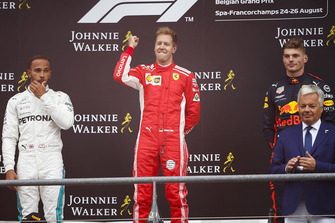 Winner Sebastian Vettel, Ferrari, celebrates on the podium, between Lewis Hamilton, Mercedes AMG F1, and Max Verstappen, Red Bull Racing