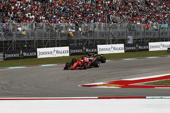 Sebastian Vettel, Ferrari SF71H and Carlos Sainz Jr., Renault Sport F1 Team R.S. 18 battle