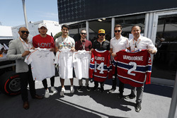 Fernando Alonso, McLaren, and Stoffel Vandoorne, McLaren, swap shirts with hockey players, including