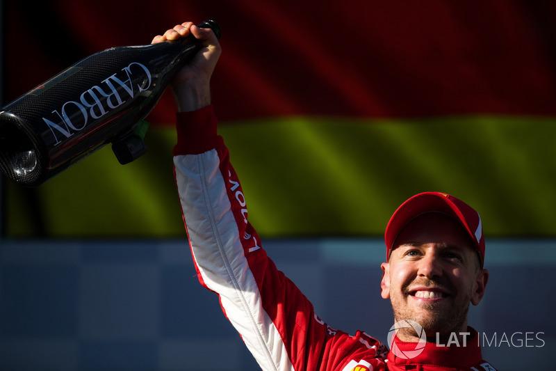 Race winner Sebastian Vettel, Ferrari celebrates on the podium with the champagne