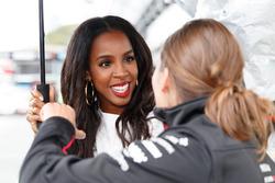 Former Destiny's Child singer Kelly Rowland chats with Simona de Silvestro, Nissan Motorsports