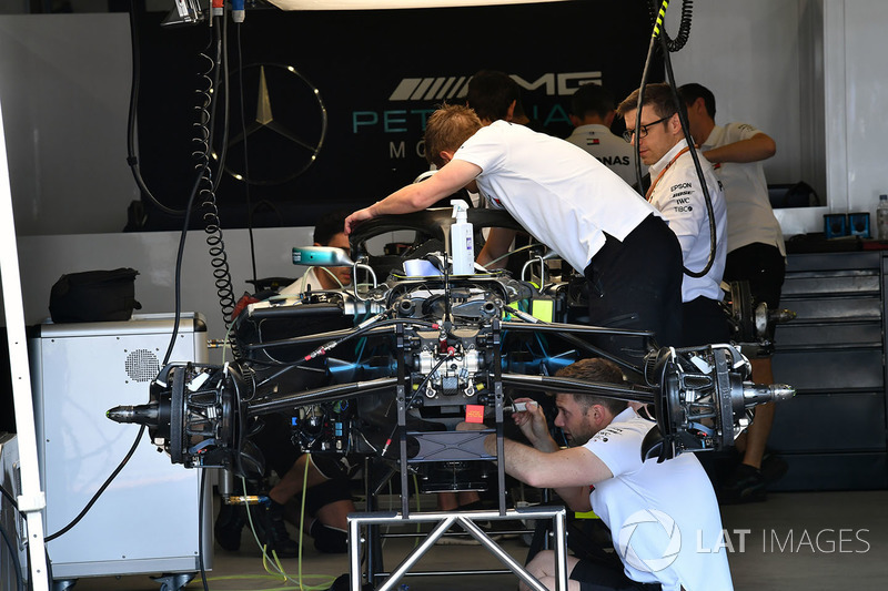 Mercedes-AMG F1 W09 EQ Power is worked on in the garage