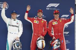 Top three Qualifiers Sebastian Vettel, Ferrari, Kimi Raikkonen, Ferrari, and Valtteri Bottas, Mercedes AMG F1