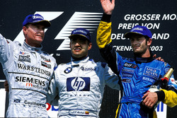 Podium: 1st Juan Pablo Montoya, BMW Williams, centre. 2nd David Coulthard, McLaren Mercedes, left. 3rd Jarno Trulli, Renault, right