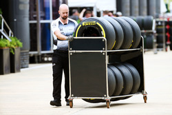 A McLaren mechanic with Pirelli tyres
