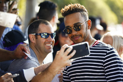 Lewis Hamilton, Mercedes AMG F1, takes a selfie with a fan
