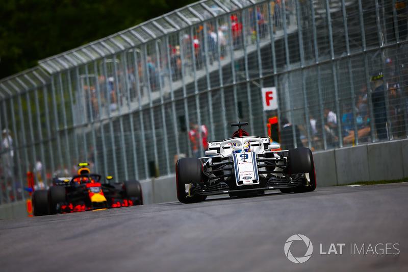 Marcus Ericsson, Sauber C37, leads Max Verstappen, Red Bull Racing RB14