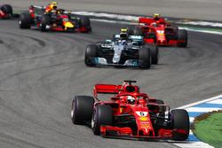 Sebastian Vettel, Ferrari SF71H, leads Valtteri Bottas, Mercedes AMG F1 W09, Kimi Raikkonen, Ferrari SF71H, and Max Verstappen, Red Bull Racing RB14