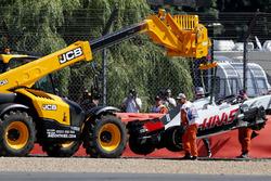 The car of Romain Grosjean, Haas VF-18 is recovered