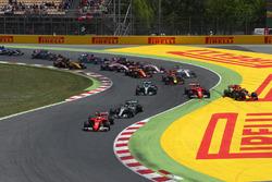Kimi Raikkonen, Ferrari SF70H and Max Verstappen, Red Bull Racing RB13 collide and crash as Sebastian Vettel, Ferrari SF70H leads at the start of the race