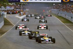 Nigel Mansell, Williams FW11 Honda leads the field on the warm up lap