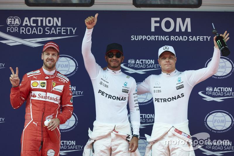 Top three qualifiers Lewis Hamilton, Mercedes AMG, Sebastian Vettel, Ferrari, and Valtteri Bottas, M