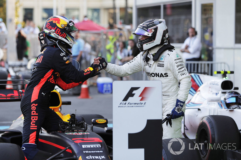 Valtteri Bottas, Mercedes AMG F1, congratulates Daniel Ricciardo, Red Bull Racing, on his victory in parc ferme