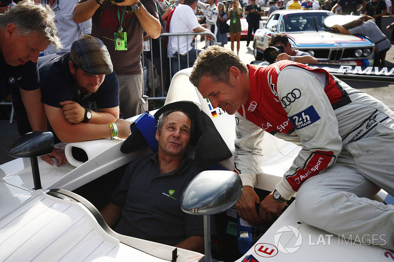Gerhard Berger, seated in a 1999 BMW V12 LMR sportscar with Tom Kristensen