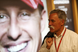 Chase Carey, Chairman, Formula One, views a portrait of Michael Schumacher